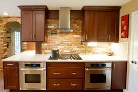 breathtaking kitchen design with brick wall wooden cabinets white