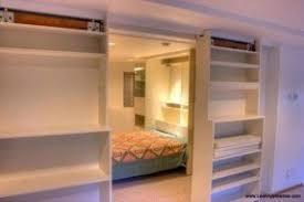 sliding bookcase door doors garage ideas