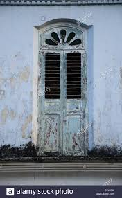 old window at british colonial era shop house it also has chinese