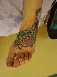 yellow flower tattoos owl and flower tattoo google search tattoos pinterest