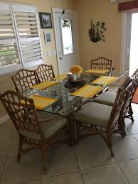 rattan glass dining set talk of the villages