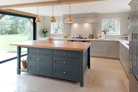 what is the true meaning of a bespoke kitchen edmondson interiors so the kitchen needed to work well with the outside the colours the simple shaker style the oak details the limestone floor harmony comes to mind