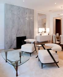 marble accent wall with white credenza living room contemporary