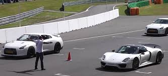 porsche 918 racing porsche 918 spyder vs 1 325 hp nissan gt r drag race proves a