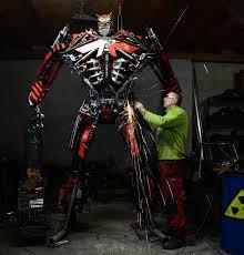 polish artist turns scrap metal into incredible sculptures bored