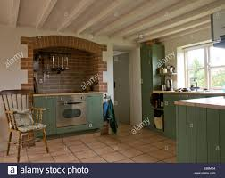 integral oven in fitted unit in modern country kitchen with pale