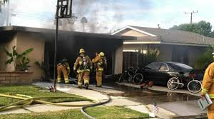 huntington beach resident injured while trying to fight house fire