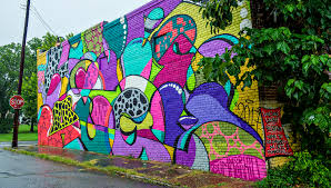 say hello to atlanta s latest batch of eye popping street murals a mural in summerhill 649 reed st by dr dax