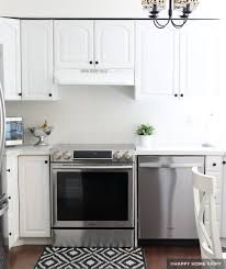 white kitchen cabinets with cathedral doors painting kitchen cabinets before after