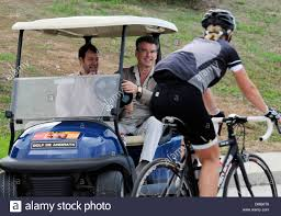 pierce brosnan strolling with a golf cart in mallorca stock photo