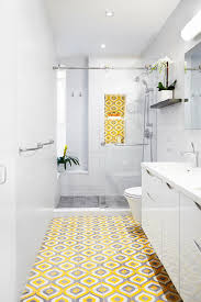 top 20 bathroom tile trends of 2017 hgtv s decorating design white bathroom with yellow floor
