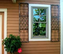 wrought iron skyview exterior window shutters