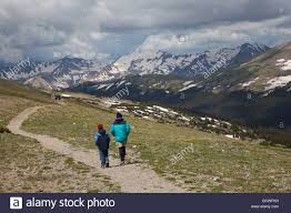 hikers on trail above tree line in rocky mountain national park