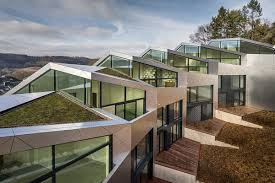 sleek multi family housing complex unfolds in luxembourg curbed