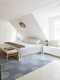this master bedroom relies on a bright white color scheme