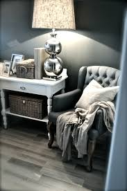 grey wall white furniture baskets and silver lamp the