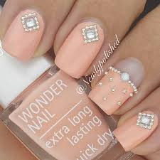 peach nails with little pearl crystal detailing x ρσℓιѕнed