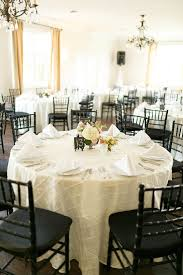 black chiavari chairs reception with ivory linens and black chiavari chairs