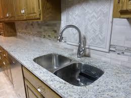 granite countertop cabinet in stainless mosaic backsplash grey