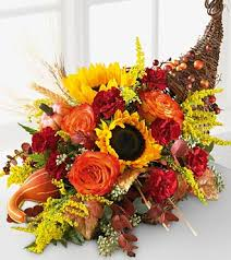 have always wanted to do an arrangement in a cornucopia see photo