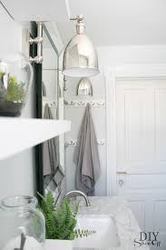 Pottery Barn Beveled Mirror Swing Arm Sconces Transitional Bathroom Valspar Pale Linen