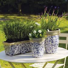 aged ceramic garden planter or plant pot by the orchard