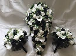 roses and lilies brides teardrop bouquet with 2 bridesmaids posies with cala lilies