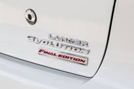 mitsubishi emblem mitsubishi usa waves goodbye to lancer evo with 2015 final edition