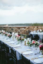 long banquet tables at this outdoor wedding reception are dressed