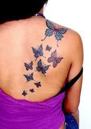outline tribal butterfly on back shoulder