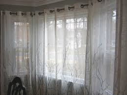 the amberican dream pvc pipes in the bay window when the curtains are closed they provide just enough privacy while still letting light in and the branches look like they could be shadows from the trees