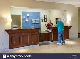florida fl new port richey holiday inn express motel hotel front desk reservations counter woman employee