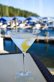 martini glass with umbrella sip cocktails by the water in idaho visit idaho