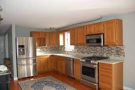how to refinish kitchen cabinets in a room featuring silver and