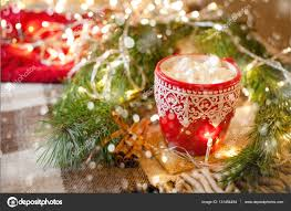 cup of hot cocoa with marshmallow with christmas decorations at cup of hot cocoa with marshmallow with christmas decorations at home christmas tree on background cozy mood photo by olkoknaeva mail ru