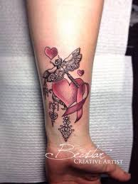 beautiful wrist tattoo of heart pink ribbon and dragonfly