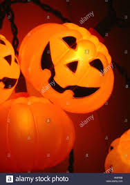 plastic pumpkins decorations strings of lights with plastic pumpkins stock