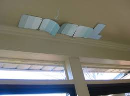 how to hang corner curtain rods u0026 painting the ceiling blue