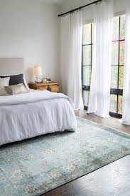 currently craving statement rugs for every space airy bedroom