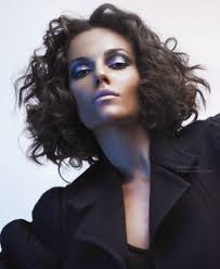 shoulder length blunt cut with razor texture for dark curly hair
