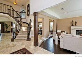 traditional entryway with travertine tile floors balcony in