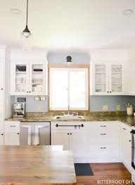 shaker kitchen cabinet doors with glass how to add glass to kitchen cabinet doors