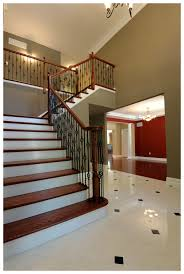 creve coeur custom home grand foyer with porcelain tile floor
