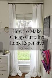 how to easily make inexpensive curtains look like custom drapes