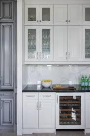 White Kitchen Cabinets With Glass Doors White Cabinets Carrara Subway Backsplash Black Granite