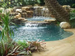 tropical backyard pool waterfall into jacuzzi tropical pool