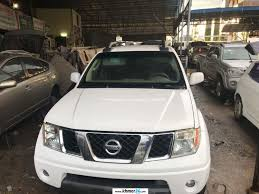 white nissan frontier i need to sell nissan frontier 2005 white le very new car in phnom