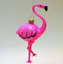 large pink flamingo lawn ornament with 4 seasonal costumes