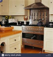 stainless steel range oven and splash back in country kitchen with
