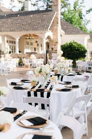 black and gold wedding decorations outdoor table setting round